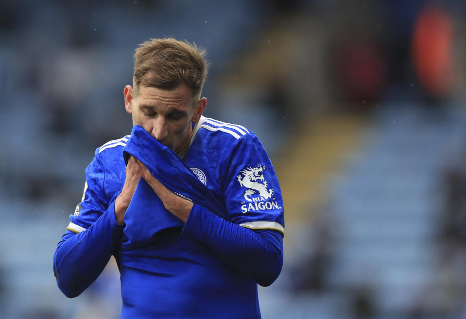 Leicester's Marc Albrighton wipes his face during the English Premier League soccer match between Leicester City and Tottenham Hotspur at the King Power Stadium, in Leicester, England, Sunday, May 23, 2021. (Mike Egerton/Pool via AP)