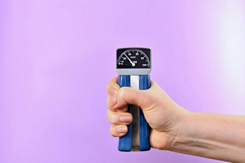 To measure grip strength, researchers use a dynamometer. Photo: Alamy