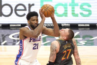 Philadelphia 76ers' Joel Embiid (21) clips Chicago Bulls' Daniel Theis' chin with his elbow as he pulls the ball up to shoot during the second half of an NBA basketball game Monday, May 3, 2021, in Chicago. (AP Photo/Charles Rex Arbogast)