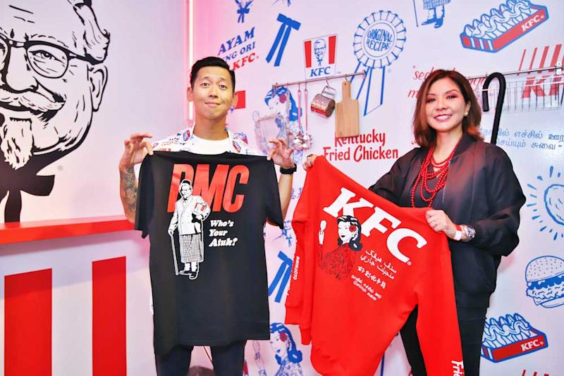 Pestle & Mortar Clothing's co-founder and creative director Hugh Koh and KFC Malaysia's chief marketing officer Angelina Villanueva with a few items from the collection. — Picture courtesy of KFC Malaysia.