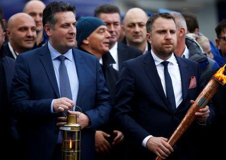 FILE PHOTO: Abdulah Skaka (R), Mayor of the city Sarajevo, and Nenad Vukovic, Mayor of East Sarajevo, attend a ceremony for the arrival of the torch for the upcoming European Youth Olympic Winter Festival in Sarajevo, Bosnia and Herzegovina February 2, 2019. Picture taken February 2, 2019. REUTERS/Dado Ruvic