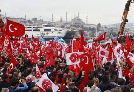 Supporters of the Nationalist Movement Party (MHP), attend an election rally for Turkey's general election on November 1, in Istanbul