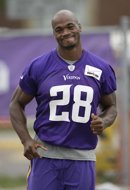 Adrian Peterson, still a bad man with the ball in his hands. (AP Photo/Charlie Neibergall)