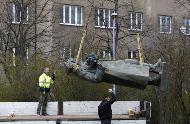 The statue of a Soviet World War II commander Marshall Ivan Stepanovic Konev is loaded onto a truck after its been removed from its site in Prague, Czech Republic, Friday, April 3, 2020. Marshall Konev led the Red Army forces that liberated Prague and large parts of Czechoslovakia from the Nazi occupation in 1945. His monument, unveiled in the Prague 6 district in 1980 when the country was occupied by Soviet troops, has been a source of controversy. (AP Photo/Petr David Josek)