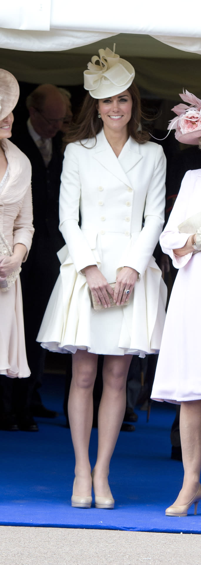 <p>Kate went for a white Alexander McQueen coat for the annual Order of the Garter service. She accessorised with nude pieces from L.K. Bennett and a chic white hat by Jane Corbett. </p><p><i>[Photo: PA]</i></p>