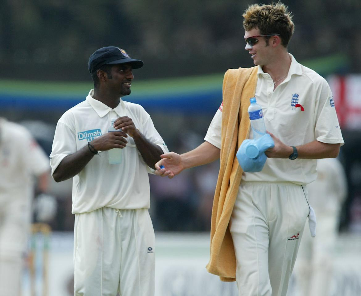 GALLE, SRI LANKA - DECEMBER 4:  Sri Lankan bowler Muttiah Muralitharan (left) has a friendly word with England twelth man James Anderson during a drinks break during day three of the first Test between Sri Lanka and England at the Galle International Stadium, on December 4, 2003, in Galle, Sri Lanka. (Photo by Stu Forster/Getty Images)