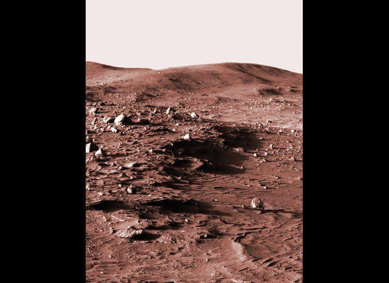 """This low-Sun panorama was shot from the Spirit Pancam, looking towards Husband Hill in the late afternoon of mission sol 813 (April 16, 2006). It seemed cooler to display the image in old-school sepia tones rather than plain old black-and-white. <em>From """"Postcards from Mars"""" by Jim Bell; Photo credit: NASA/JPL/Cornell University</em>"""