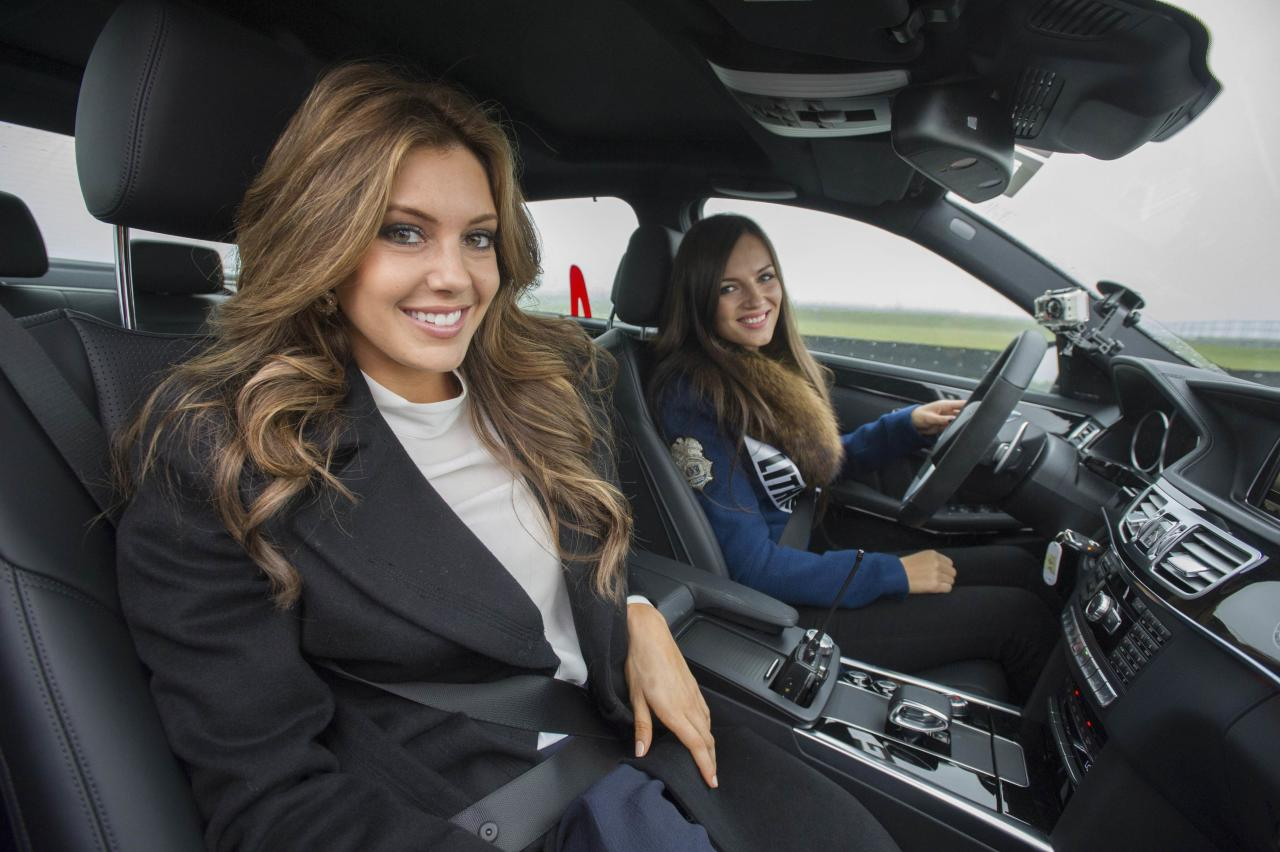 Miss Lithuania 2013 Simona Burbaite (R) and Miss U.S.A. 2013 Erin Brady pose for a photo in a car at Moscow Raceway October 28, 2013. Miss Universe will be held at Crocus City Hall in Moscow on November 9. REUTERS/Darren Decker/Miss Universe Organization/Handout via Reuters (RUSSIA - Tags: SOCIETY ENTERTAINMENT TRANSPORT) ATTENTION EDITORS - NO SALES. NO ARCHIVES. FOR EDITORIAL USE ONLY. NOT FOR SALE FOR MARKETING OR ADVERTISING CAMPAIGNS. THIS IMAGE HAS BEEN SUPPLIED BY A THIRD PARTY. IT IS DISTRIBUTED, EXACTLY AS RECEIVED BY REUTERS, AS A SERVICE TO CLIENTS