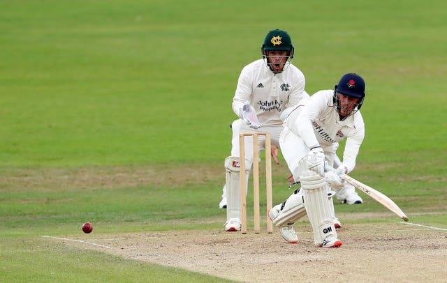 Lancashire's Luke Wood (right) will resume on 63 not out