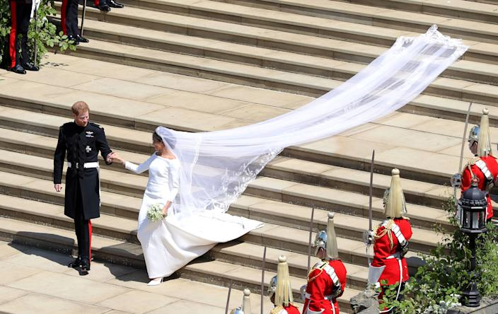 The Duchess of Sussex's wedding gown hinted at the diplomatic wardrobe we could expect in the future [Photo: PA]