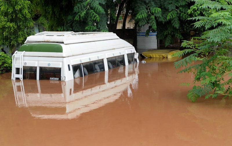 A vehicle submerged in water outside Baltana police post after Sukhna lake swelled and floodgates were opened during a heavy rain spell, on August 22, in Zirakpur, on August 23, 2020 inChandigarh, India. (Photo by Keshav Singh/Hindustan Times via Getty Images)