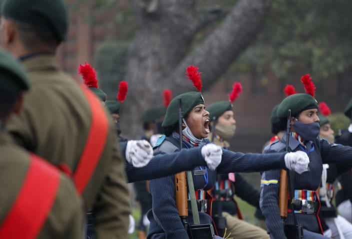 National Cadet Corp students march in a parade as they practice for the upcoming Republic Day parade at the Raisina hills, the government seat of power, in New Delhi, India, Monday, Jan. 18, 2021. Republic Day marks the anniversary of the adoption of the country's constitution on Jan. 26, 1950. Thousands congregate on Rajpath, a ceremonial boulevard in New Delhi, to watch a flamboyant display of the country's military power and cultural diversity. (AP Photo/Manish Swarup)