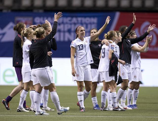 VANCOUVER, CANADA - JANUARY 27: Members of team United States salute their fans after defeating Costa Rica 3-0 during semifinals action of the 2012 CONCACAF Women's Olympic Qualifying Tournament at BC Place on January 27, 2012 in Vancouver, British Columbia, Canada. The United States have now qualified for the 2012 Summer Olympic Games in London. (Photo by Rich Lam/Getty Images)