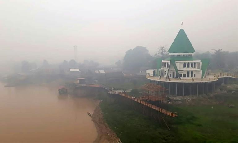 Haze from forest fires shrouds a a mosque in Palangkaraya, central Kalimantan, in Indonesia