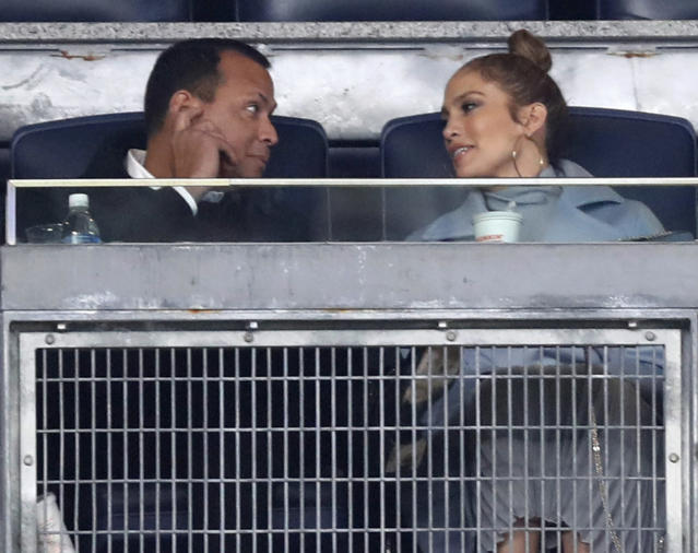 "Jennifer Lopez teaches Alex Rodriguez about ""Moneyball"" in video. (AP Photo/Kathy Willens)"