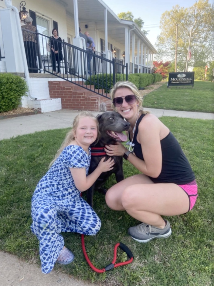 Raelynn Nast with Emily Beineman and her dog, Blue. / Credit: Handout