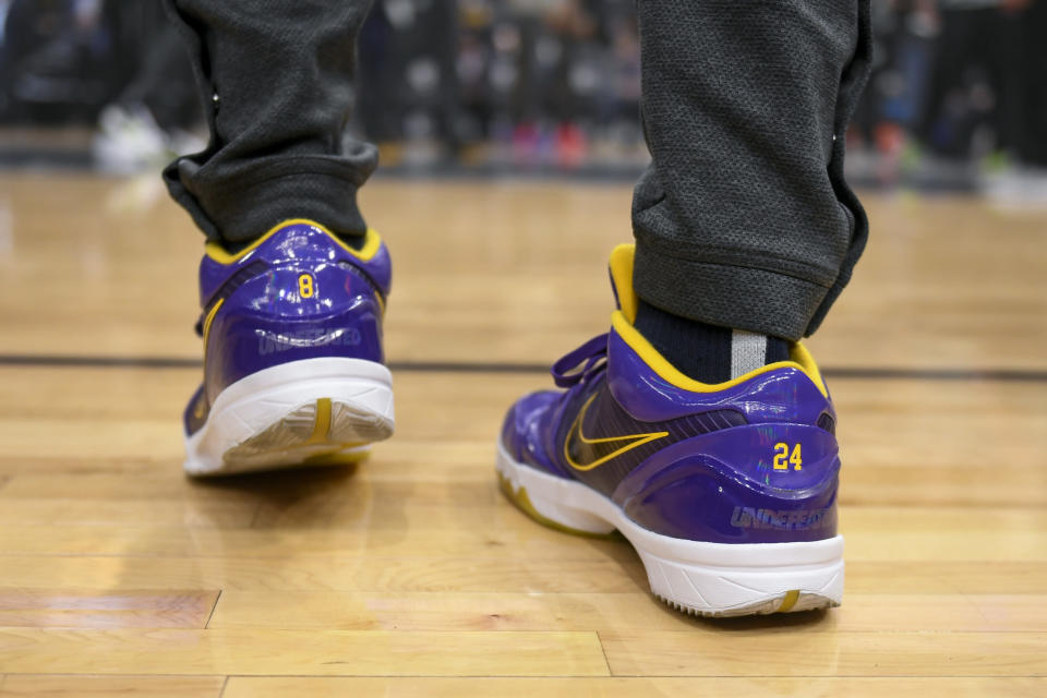 Minnesota Timberwolves forward Keita Bates-Diop wears shoes with the number 8 and 24, in tribute to Kobe Bryant who died Sunday in a helicopter crash, before the start of their NBA basketball game against the Sacramento Kings Monday, Jan. 27, 2020, in Minneapolis. (AP Photo/Craig Lassig)