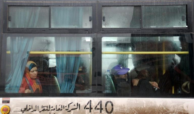 Syrians aboard a bus from government-held Fuaa and Kafraya arrive in rebel-held Rashidin, west of Aleppo city, as part of an evacuation deal