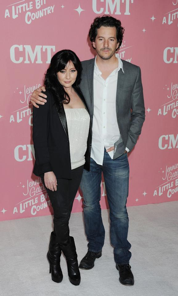 "Shannen Doherty and Kurt Iswarienko arrive at Jennie Garth's 40th birthday celebration & premiere party for ""<a target=""_blank"" href=""http://tv.yahoo.com/jennie-garth-little-bit-country/show/48388"">Jennie Garth: A Little Bit Country</a>"" held at The London Hotel on April 19, 2012 in West Hollywood, California."