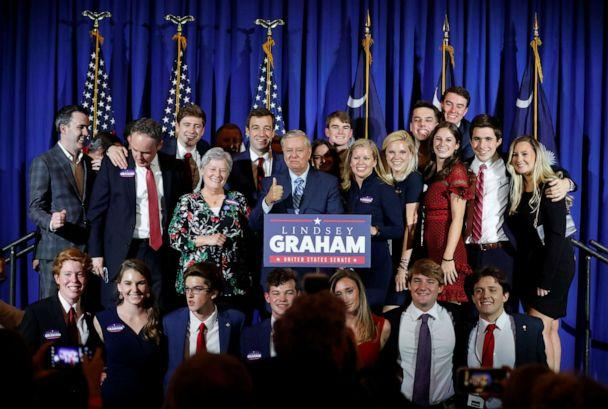 PHOTO: Sen. Lindsey Graham gives a thumbs-up as he takes a group picture at his election night party in Columbia, S.C., Nov. 3, 2020. (Sam Wolfe/Reuters)