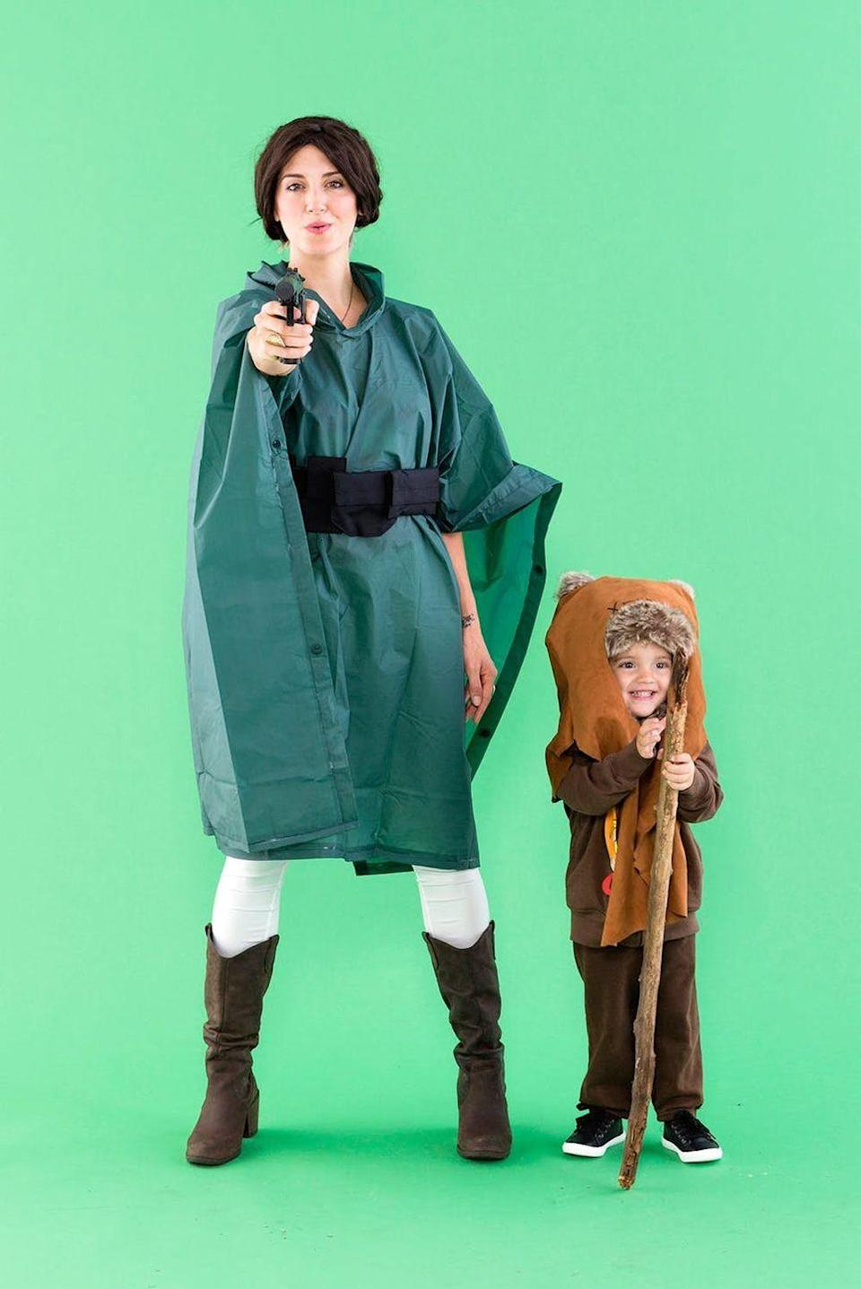 """<p>A green poncho is the genius base of this mom's Leia costume. Seriously, how snuggly is that baby Ewok in his brown sweatsuit?</p><p><strong>Get the tutorial at <a href=""""https://www.brit.co/star-wars-leia-ewok-halloween-costumes/"""" rel=""""nofollow noopener"""" target=""""_blank"""" data-ylk=""""slk:Brit & Co"""" class=""""link rapid-noclick-resp"""">Brit & Co</a>.</strong></p><p><strong><a class=""""link rapid-noclick-resp"""" href=""""https://www.amazon.com/gp/product/B009KSSKMI/?tag=syn-yahoo-20&ascsubtag=%5Bartid%7C10050.g.21287723%5Bsrc%7Cyahoo-us"""" rel=""""nofollow noopener"""" target=""""_blank"""" data-ylk=""""slk:SHOP GREEN PONCHO"""">SHOP GREEN PONCHO</a></strong></p>"""