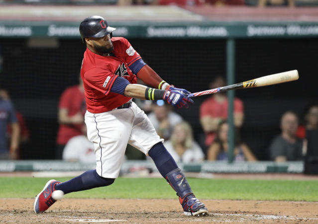 Cleveland Indians' Carlos Santana swings for strike three in the eighth inning of a baseball game against the Kansas City Royals, Saturday, July 20, 2019, in Cleveland. (AP Photo/Tony Dejak)