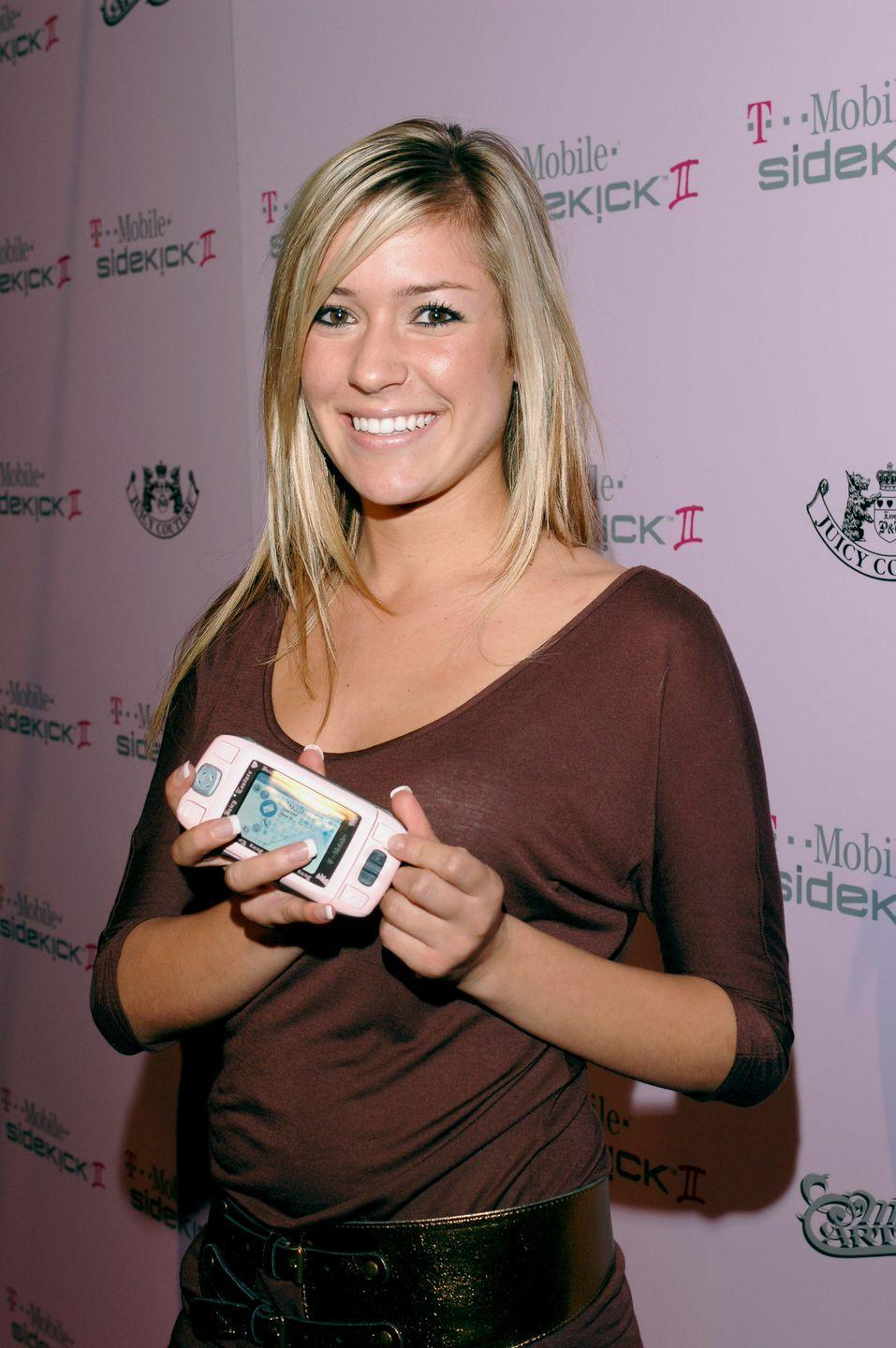 """<p>The """"baddie"""" of MTV's <em>Laguna Beach</em>, Kristin Cavallari, poses with the latest and greatest T-Mobile Sidekick II, aka the most coveted cell phone of the 2000s. </p>"""