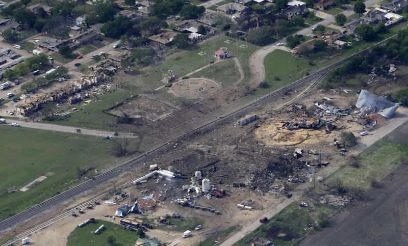 FILE - This April 18, 2013 file photo shows an aerial view of the remains of a fertilizer plant and an apartment complex to the left, destroyed by an explosion in West, Texas that killed as many as 15 people and injured more than 160. As a wave of new fertilizer plant construction and expansion is being proposed across the United States, this deadly explosion highlights how dangerous some of the chemicals used to make fertilizer can be, and how inconsistently they're regulated. (AP Photo/Tony Gutierrez, File)