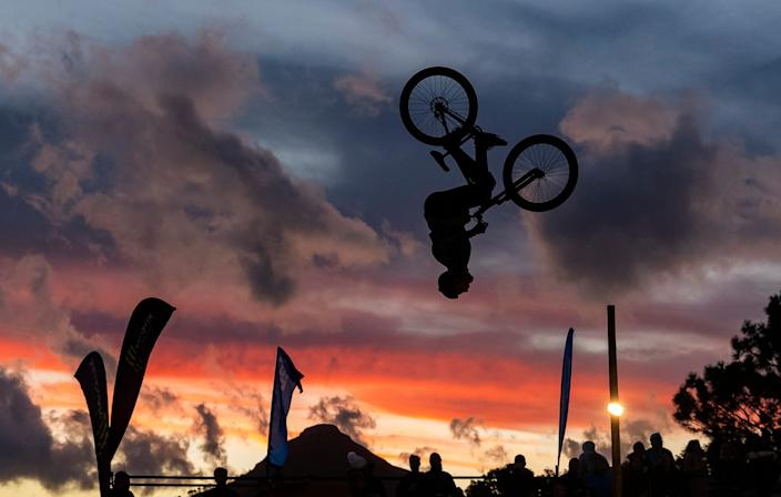 A BMX rider hits a back flip during a competition in South Africa.