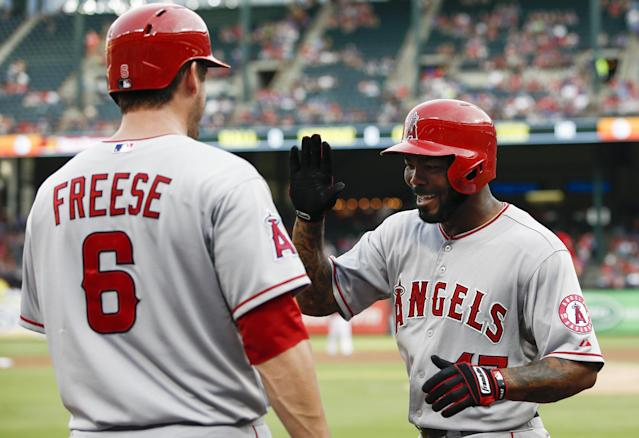 Los Angeles Angels' Howie Kendrick (47) is congratulated by David Freese (6) following his solo home run against the Texas Rangers during the second inning of a baseball game, Saturday, Aug. 16, 2014, in Arlington, Texas. (AP Photo/Jim Cowsert)