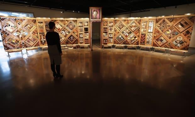 In this file photo, visitors to the Canadian Museum for Human Rights in Winnipeg visit an exhibit called The Witness Blanket, comprised of more than 800 items collected from the sites and survivors of residential schools. The Law Society of B.C. has disciplined a lawyer who admitted to professional misconduct arising from his representation of survivors of residential schools. (The Canadian Press/John Woods - image credit)