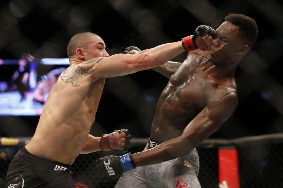 Robert Whittaker (left) is seeking to bounce back after losing his belt to Israel Adesanya (Getty Images)