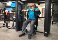 A man is seen exercising at a gym in Amman