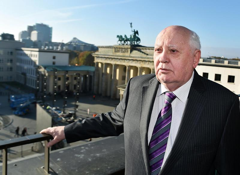 Former President of the Soviet Union Mikahil Gorbachev enjoys the view of Brandenburger Gate before attending a symposium on security in Europe 25 years after the fall of the Berlin Wall, November 8, 2014