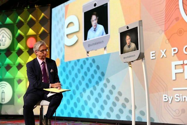 Bob Pisani of CNBC (L) speaks to Ray Kurzweil, who beamed in from San Francisco. (Singularity University)