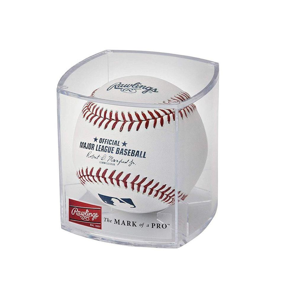 """<p><strong>Rawlings</strong></p><p>amazon.com</p><p><strong>$18.37</strong></p><p><a href=""""https://www.amazon.com/dp/B000096OJL?tag=syn-yahoo-20&ascsubtag=%5Bartid%7C10060.g.35049077%5Bsrc%7Cyahoo-us"""" rel=""""nofollow noopener"""" target=""""_blank"""" data-ylk=""""slk:Shop Now"""" class=""""link rapid-noclick-resp"""">Shop Now</a></p><p>If you're a sports fan with various forms of memorabilia, it can be hard to not feel cluttered. </p><p>Though you might be tempted to clear it out and just dump it, you should consider showcasing it at your next garage sale or dropping it off as a donation. Shoppers will be tempted to snag sports memorabilia since it will <em>really</em> pop out to a fan among other things on display.</p>"""