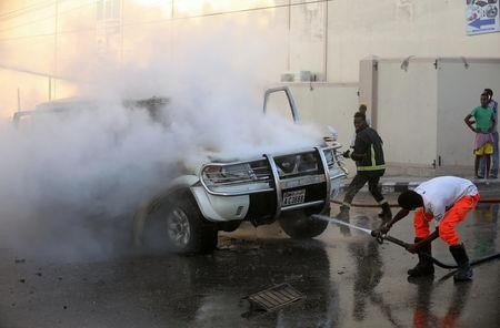 Fire fighters attempt to extinguish a burning car after an explosion in Mogadishu, Somalia September 22, 2018. REUTERS/Feisal Omar