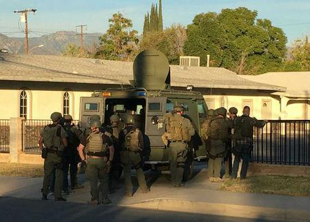 A police SWAT team searches a church during a manhunt after a mass shooting in San Bernardino, California December 2, 2015. REUTERS/Mike Blake