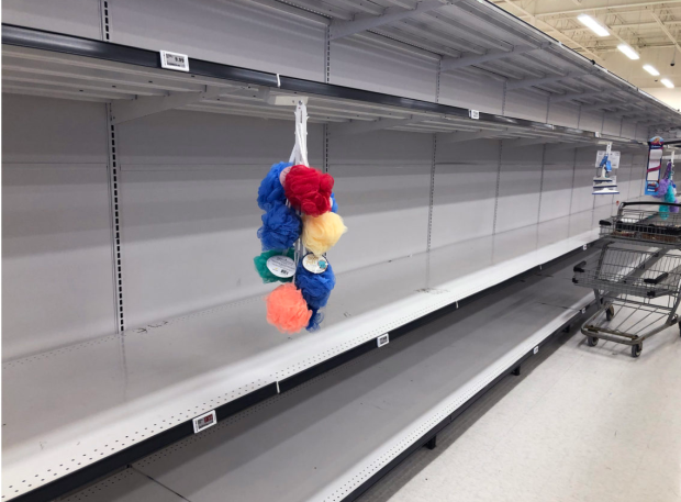 Panic buying meant many store shelves were cleared out, as customers stocked up on goods they feared might become inaccessible.