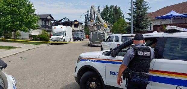 Chestermere RCMP on Friday at the scene of a house fire.  (Justin Pennell/CBC - image credit)