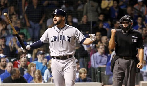 San Diego Padres' Yonder Alonso reacts after being called out on strikes with the bases loaded by home plate umpire Mark Carlson during the seventh inning of a baseball game against the Chicago Cubs, Monday, April 29, 2013, in Chicago. (AP Photo/Charles Rex Arbogast)