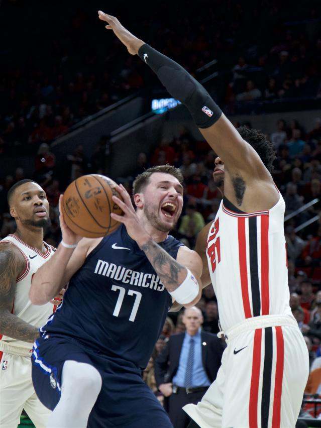 Dallas Mavericks guard Luka Doncic (77) drives to the basket past Portland Trail Blazers center Hassan Whiteside during the first half of an NBA basketball game in Portland, Ore., Thursday, Jan. 23, 2020. (AP Photo/Craig Mitchelldyer)