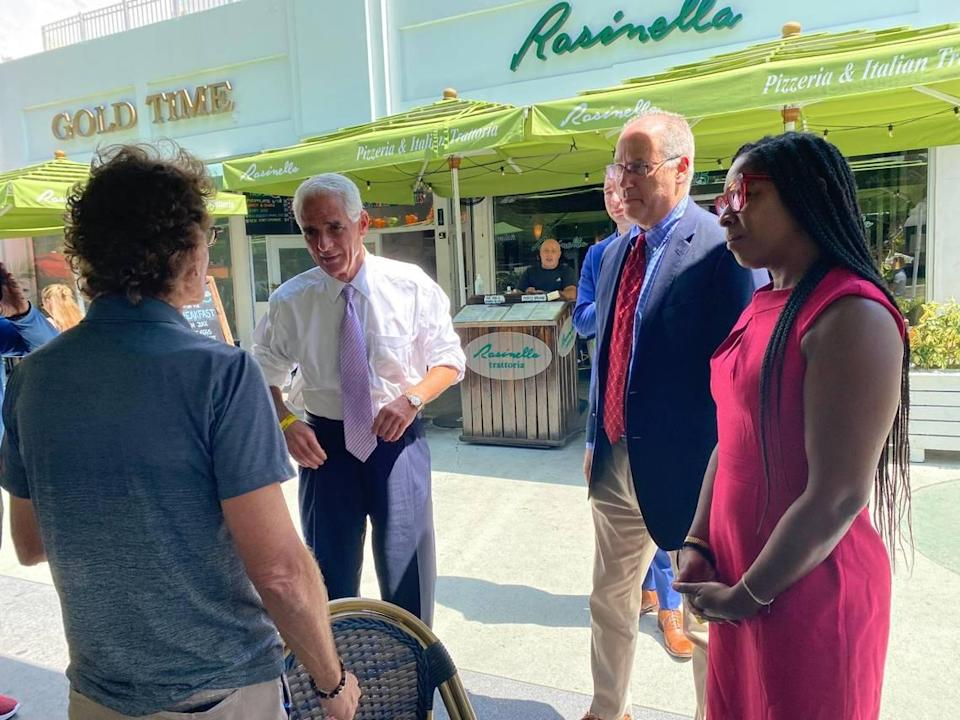 Gubernatorial candidate and U.S. Rep. Charlie Crist, D-St. Petersburg, (left) at a campaign stop in Miami Beach on Friday morning with Mayor Dan Gelber, speaking with local small business leaders.