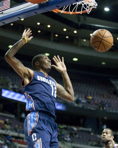 Charlotte Bobcats forward Tyrus Thomas watches his dunked ball during the first half of an NBA preseason basketball game against the Detroit Pistons on Saturday, Oct. 20, 2012, in Auburn Hills, Mich. (AP Photo/Duane Burleson)