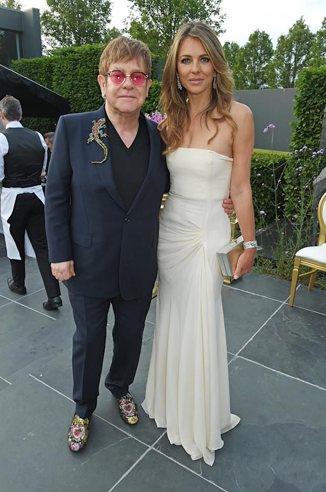 <p>Fancy! The stars, including John's friend Hurley, came out for the Woodside Gallery Dinner, benefitting the singer's Elton John AIDS Foundation, in Windsor, England. (Photo: David M Benett/Dave Benett/Getty Images for BVLGARI) </p>