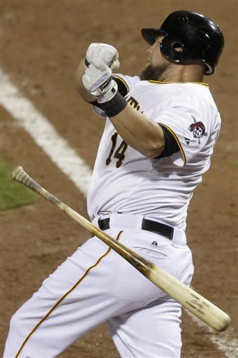 Pittsburgh Pirates' Casey McGhee (14) loses the grip on his bat while swinging at a pitch from Cincinnati Reds pitcher Mike Leake during the seventh inning of a baseball game in Pittsburgh, Saturday, May 5, 2012. (AP Photo/Gene J. Puskar)