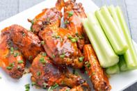 """<p>No Super Bowl spread would be complete without Buffalo wings. These are doused in ranch seasoning and fresh chives for extra flavor. </p><p><em><a href=""""https://www.delish.com/cooking/recipe-ideas/recipes/a44367/slow-cooker-buffalo-ranch-wings-recipe/"""" rel=""""nofollow noopener"""" target=""""_blank"""" data-ylk=""""slk:Get the recipe at Delish »"""" class=""""link rapid-noclick-resp"""">Get the recipe at Delish »</a></em></p>"""