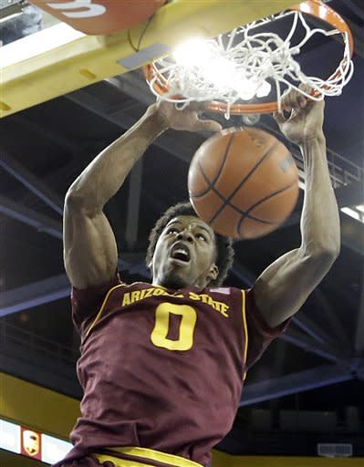 Arizona State guard/forward Carrick Felix (0) slam dunks against UCLA in the first half of an NCAA college basketball game in Los Angeles Wednesday, Feb. 27, 2013. (AP Photo/Reed Saxon)