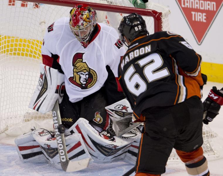 Anaheim Ducks left wing Patrick Maroon shoots on Ottawa Senators goalie Craig Anderson during the first period of an NHL hockey game, Friday Oct. 25, 2013 in Ottawa, Ontario. (AP Photo/The Canadian Press, Adrian Wyld)