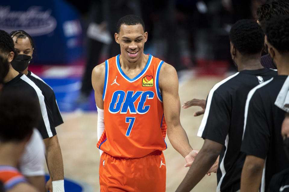 DETROIT, MICHIGAN - APRIL 16: Darius Bazley #7 of the Oklahoma City Thunder high fives his teammates during a timeout in the first quarter of the NBA game against the Detroit Pistons at Little Caesars Arena on April 16, 2021 in Detroit, Michigan. NOTE TO USER: User expressly acknowledges and agrees that, by downloading and or using this photograph, User is consenting to the terms and conditions of the Getty Images License Agreement.